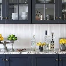 fantastic striking kitchen featuring white shiplap walls navy blue