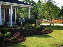 front yard landscaping ideas showing green garden with green grass