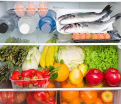 a refrigerator full of healthy food mediterranean diet stock