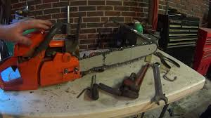 husqvarna chainsaw removing clutch oiler repair and sharpening