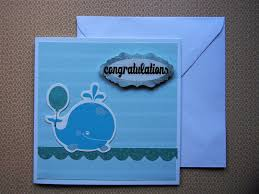 baby boy congratulations card in light blue with cute whale