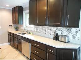 kitchen with black countertops and brown cabinets personalised