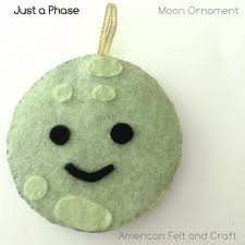 just a phase glow in the felt moon ornament american