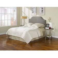 bedroom cozy pergo flooring with white cotton sheets and gray