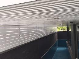 to enclose swimming pool area with aluminium trellis wall screen