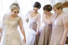 charlene morton wedding photography bridesmaids help bride get ready
