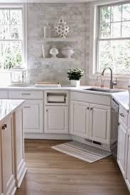 tile backsplash in kitchen smoke glass subway tile white shaker cabinets shaker cabinets