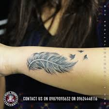 feather tattoo meanings archives black poison tattoo studio