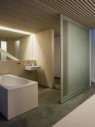 modern minimalist bathroom design with frosted glass sliding door