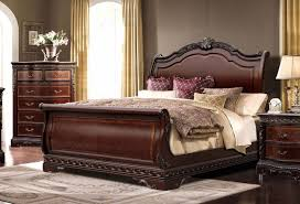 traditional ornate queen sleigh bed with mahogany finish
