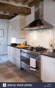modern stainless steel extractor and range oven in italian country