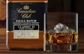 whiskey photography canadian club small batch whiskey bottle and glass captured at the