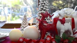 White Christmas Centerpieces - stylish red and white christmas table with reindeers and candles