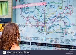 Catalonia Spain Map by Woman Looking At A Subway Map Barcelona Catalonia Spain Stock