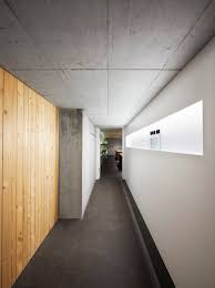exposed concrete walls and raw asphalt flooring contrast the