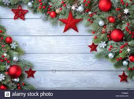 christmas background with blue wooden board and fir branches stock
