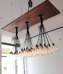Wood Light Fixture 25 Beautiful Diy Wood Ls And Chandeliers That Will Light Up