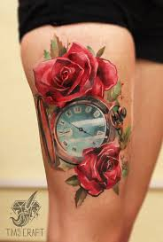 two red roses with pocket watch tattoo on thigh by tymur