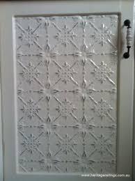 metal cabinet door inserts faux tin tile cabinets doors wallpaper and glaze