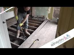removing insulating and restoring a suspended wooden floor part