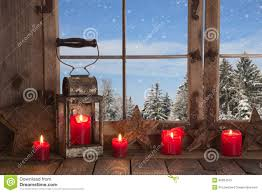 outdoor christmas window decoration with red candles deer and t