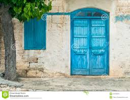 blue front door with window and tree in cyprus stock photo image