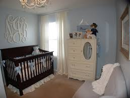 baby boy nursery with monogram above the crib perfect shade of