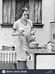 1920s women in kitchen cooking stock photo royalty free image