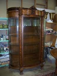 antique curio cabinet with curved glass tiger oak curved glass curio cabinet with lion s head and claw feet