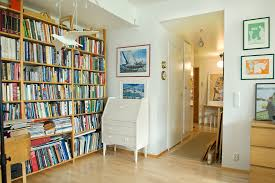 great room decorations with large wooden bookselves room devider