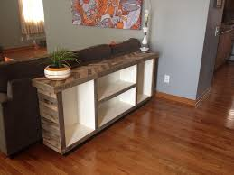 console table behind sofa behind the couch table console look elegant and orderly behind the