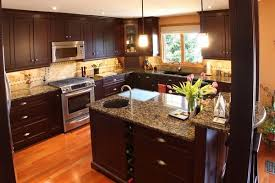what color cabinets go with brown granite baltic brown granite countertops texture and charm to the