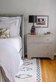 gray linen nailhead nightstand with purple quartz lamp