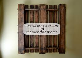 How To Hang A Picture The Domestic Doozie How To Hang A Pallet
