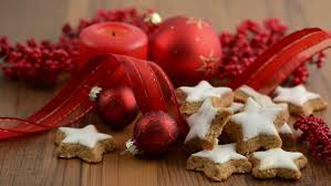 lit a candle aside christmas sweets like cinnamon pastry and