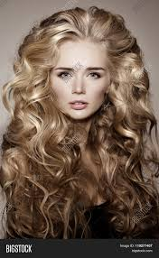 model with blonde long hair waves curls hairstyle hair salon