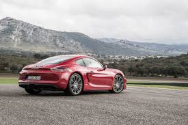 carmine red porsche the new porsche cayman gts is the antidote to overkill maxim
