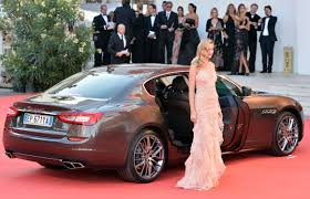 maserati ghibli red 2015 stars ride the maserati quattroporte on the red carpet in venice