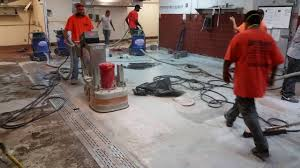 brilliant epoxy floors inc grinding off a coating in a commercial