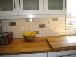 tile pictures for kitchen backsplashes stainless steel interspersed with white subway tile kitchen