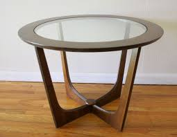 round glass coffee table with wood base
