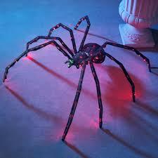 halloween spider web lights the 36 inch twitching lighted spider hammacher schlemmer