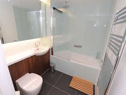 bathroom and closet designs bathroom impressive bathtub with glass door and divider wooden
