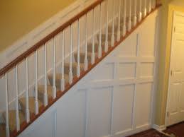 Stair Trim Molding by Wainscoting To Cover The Entire Living Room Under Stairs Closet