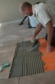 Ceramic Tile Flooring Installation How To Lay Tile Install A Ceramic Tile Floor In The Bathroom
