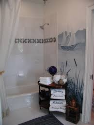 bathroom design glass tile and real shell border in the shower