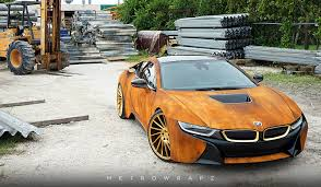 rusty car driving this rust wrapped bmw i8 will either please or disgust you