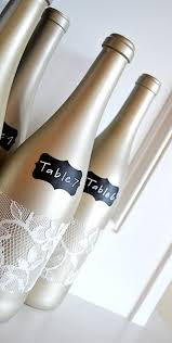 gold wine bottle table numbers chagne lace chalkboard table number centerpiece wedding ideas