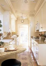 kitchen cabinets galley style galley style kitchen with natural cream colors and beadboard ceiling