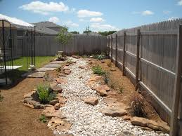 native plantings dry creek bed with decomposed granite beds and flagstone pathway